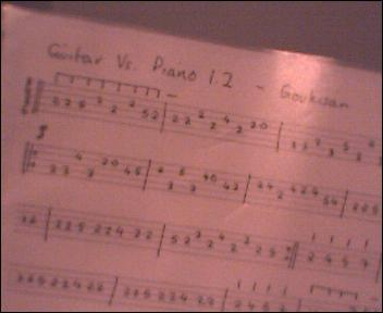 Hooray! I finshed tabbing Guitar Vs. Piano!