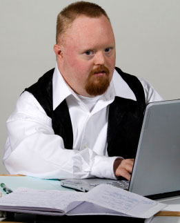 3124291_139669783511_adult-man-with-downs-syndrome-working-studying.jpg