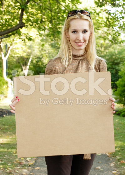 1696970_145465073683_stock-photo-4461865-woman-with-blank-cardboard-sign.jpg